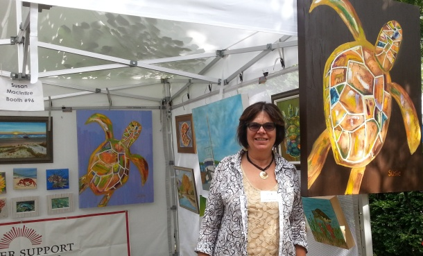 Susan Macintire with her art during 2013 Outdoor Show