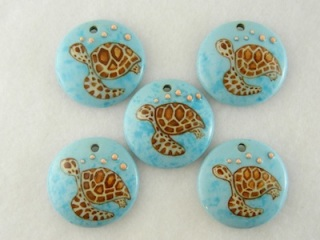 porcelain beads with turtles by Susan Turfle