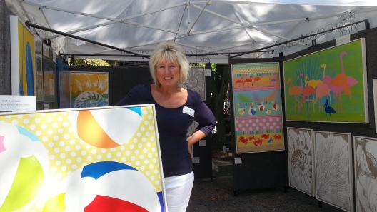 Nina Mickelsen of Clarissa Studio Art at her booth during the 2013 RAL Outdoor Show